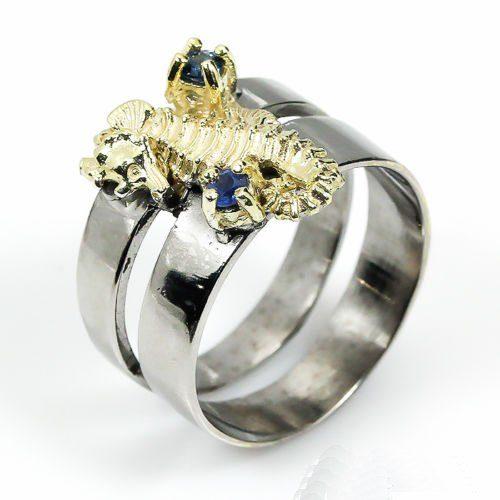 טבעת בשיבוץ אבני ספיר כחול עבודת יד כסף 925 וציפוי זהב מידה: 8.25