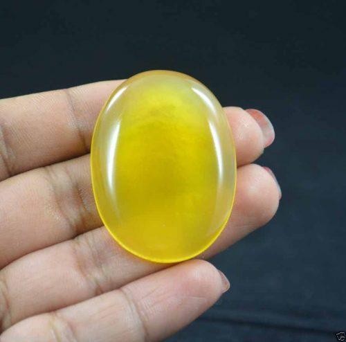 """אוניקס צהוב מלוטש לשיבוץ (אפריקה) 84.50 קרט מידות: 7.50*31.45*43.17 מ""""מ"""