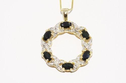 תכשיט יוקרה: תליון כסף 925 וציפוי זהב בשיבוץ יהלומים וספירים עיצוב עגול