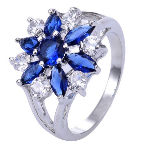 טבעת כסף 925 בשיבוץ. ספיר כחול וטופז לבן מידה: 8 הטבעת: 4.8 גרם