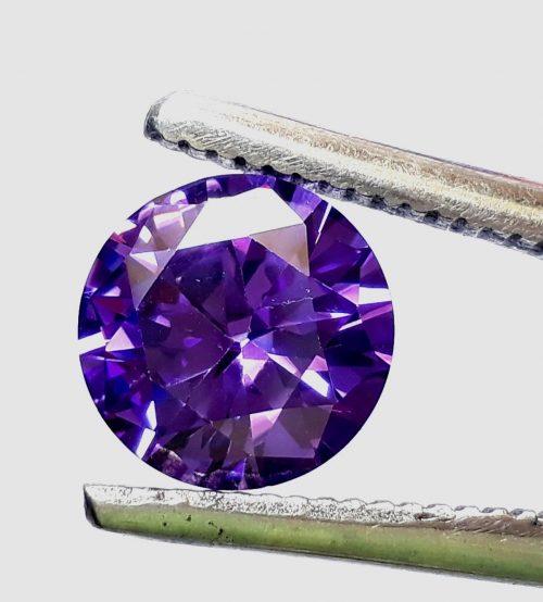 """זירקון Zircon טבעי סגול ליטוש עגול (קמבודיה) 5.50 קרט קוטר: 9 מ""""מ עומק: 5 מ""""מ"""