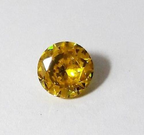 """זירקון טבעי צהוב ליטוש עגול (קמבודיה) 5.50 קרט קוטר: 9 מ""""מ עומק: 5 מ""""מ"""