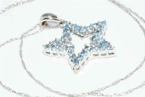 תליון ושרשרת זהב לבן 10 קרט בשיבוץ 30 טופז כחול 1.01 קרט בשיבוץ 1 יהלום 01. קרט