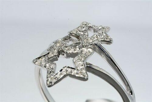 טבעת זהב לבן 10 קרט עיצוב כוכבים בשיבוץ 10 יהלומים לבנים 06. קרטמידה: 7