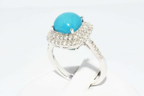 טבעת כסף 925 בשיבוץ טופז כחול 4.5 קרט בשיבוץ 62 אבני טופז לבן 75. קרט מידה: 7.25
