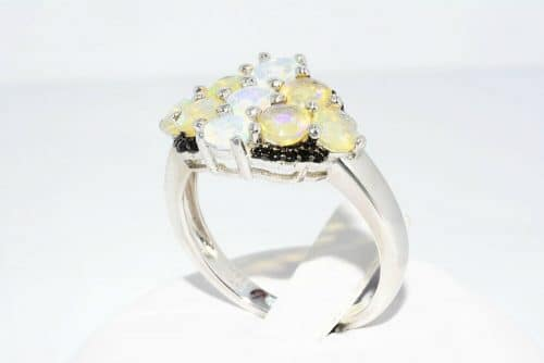 טבעת יוקרה כסף 925 בשיבוץ 9 אופל אש 2.10 קרט + 20 אוניקס שחור 20. קרט מידה: 8