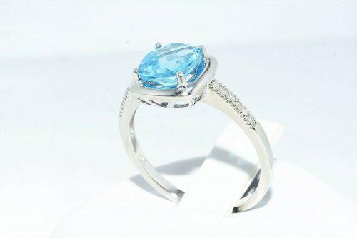 טבעת זהב לבן 10 קרט משובץ טופז לונדון 1.60 קרט + 12 יהלומים 05. קרט מידה: 7