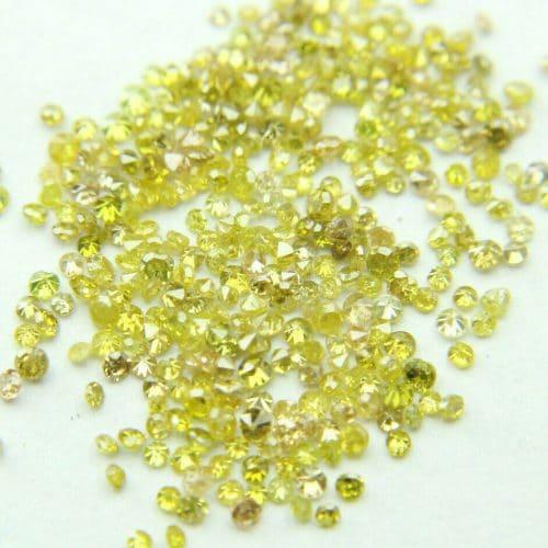 """50 יהלומים צהובים Natural diamond לשיבוץ ליטוש עגול בקוטר: 0.70 מ""""מ ניקיון: i1-i3"""